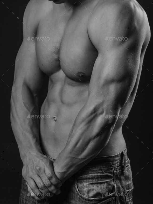 Perfectly fit shirtless young man - Stock Photo - Images