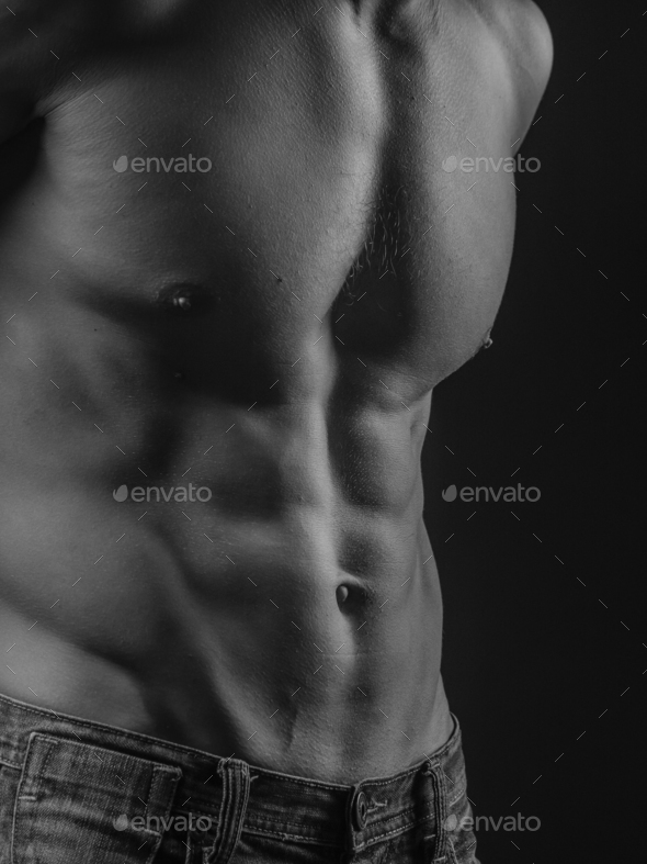 Abdominal muscles of a fit young man - Stock Photo - Images