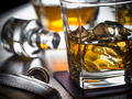 Whiskey on the rocks on a wooden table - PhotoDune Item for Sale