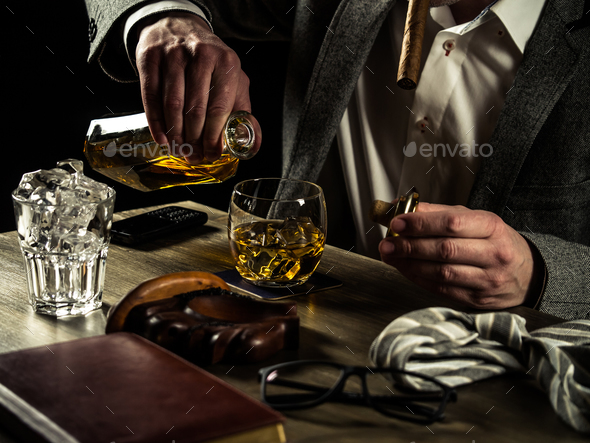 Drinking whiskey at night - Stock Photo - Images