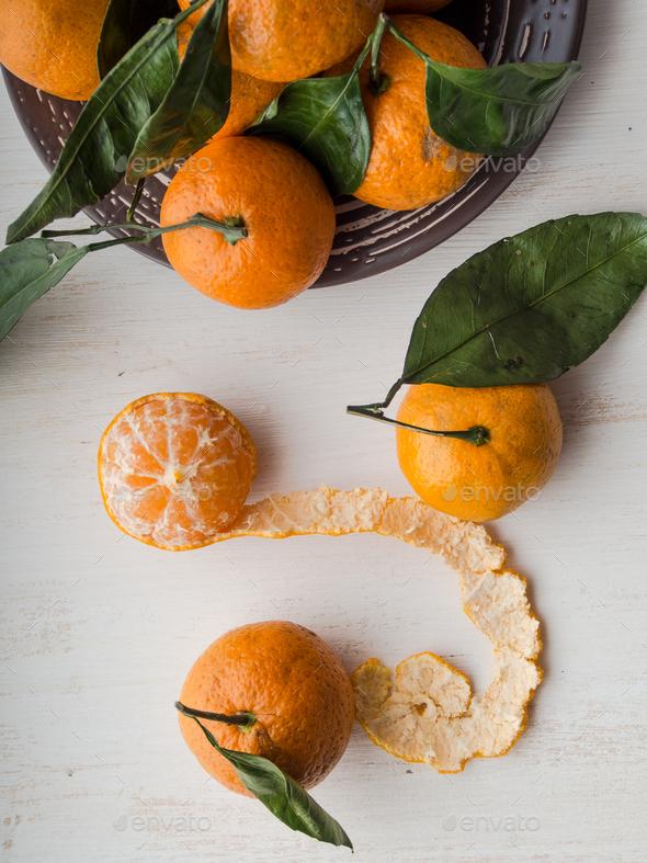 Fresh whole and peeled  tangerines - Stock Photo - Images