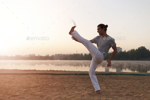 Capoeira on the beach, near lake in the park one performer, at s - Stock Photo - Images