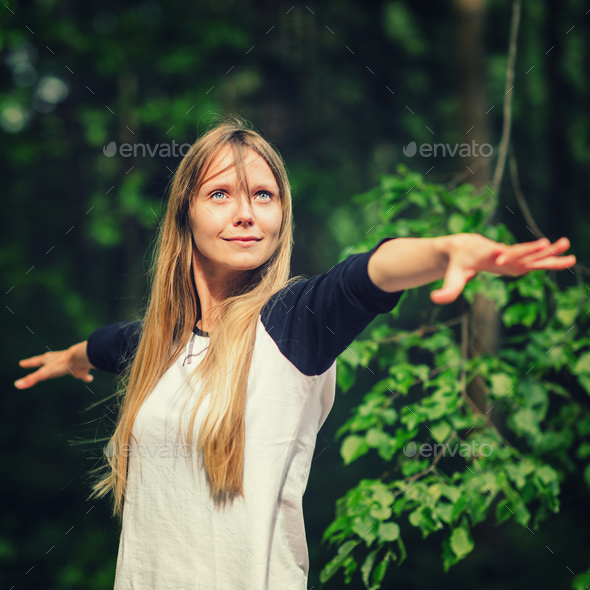 Beautiful young woman doing yoga in the park - Stock Photo - Images