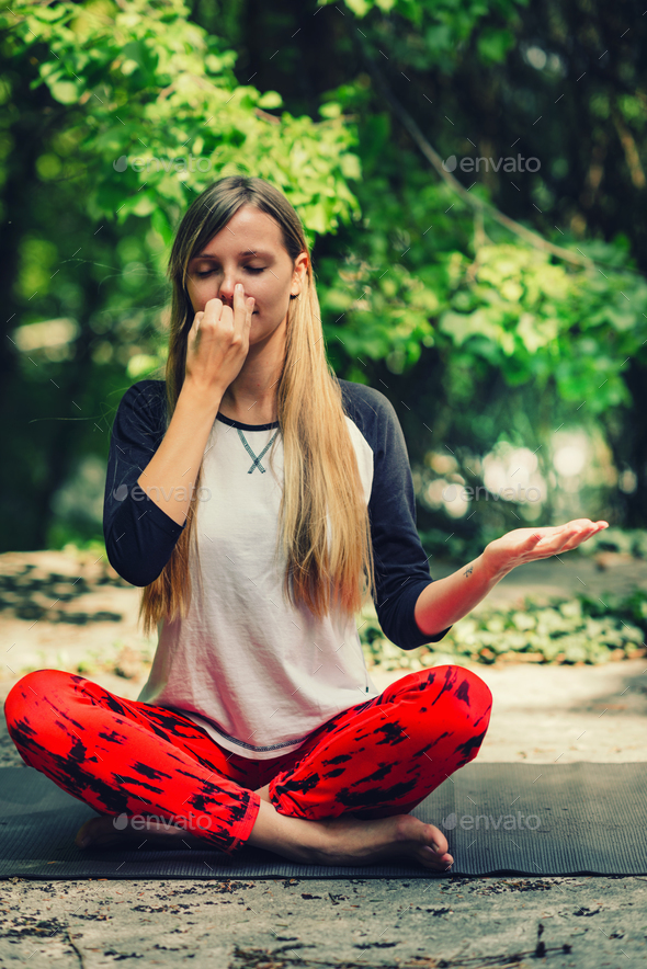 Pranayama. Alternate nostril breathing exercise in yoga - Stock Photo - Images