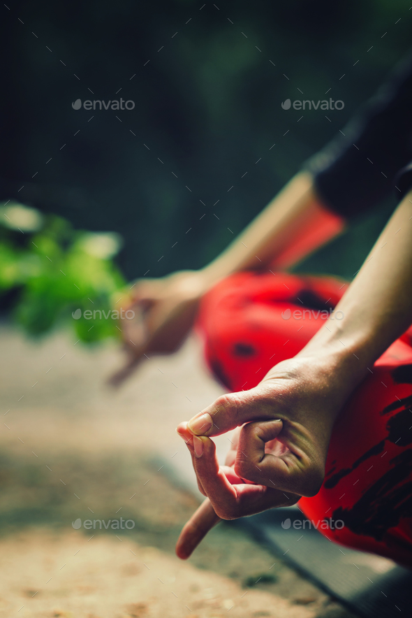 Meditation detail. Close-up on hands of a young woman meditating - Stock Photo - Images