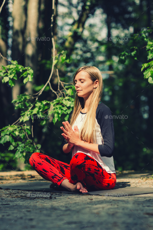 Meditation. Positive young woman meditating outdoors - Stock Photo - Images