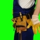 Worker Takes out a Screwdriver from His Construction Belt on Green Screen - VideoHive Item for Sale
