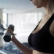 Beautiful Young Woman Exercising in Fitness Gym - VideoHive Item for Sale