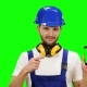 Man in a Builder's Suit Advertises a Smartphone on Green Screen - VideoHive Item for Sale