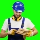 Builder Holds the Wooden Boards in His Hands and Smiles on Green Screen - VideoHive Item for Sale