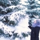 Winter Snow Falls Slowly From a Tree, a Girl Touches Tree Branches, Snow Falls - VideoHive Item for Sale