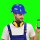 Foreman Holds a Phone in His Hands and Shows a Thumbs up on Green Screen - VideoHive Item for Sale