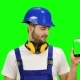 Builder Holds a Phone in His Hands and Shows a Thumbs up on Green Screen - VideoHive Item for Sale