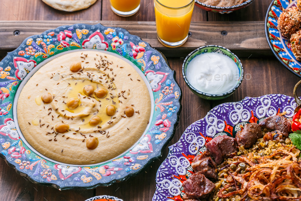 Homemade hummus with pita in traditional plate - Stock Photo - Images