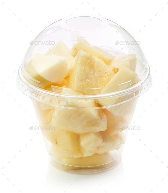 fresh pineapple pieces salad in plastic cup - Stock Photo - Images