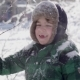 Joyful Charming Child Shakes a Snow-covered Branch - VideoHive Item for Sale