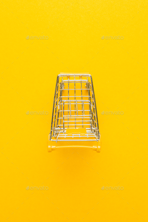Top View Of Shopping Trolley On Yellow  - Stock Photo - Images