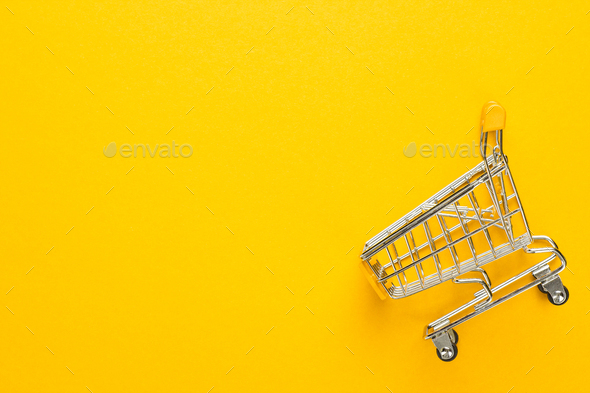 Shopping Trolley On Yellow Background  - Stock Photo - Images