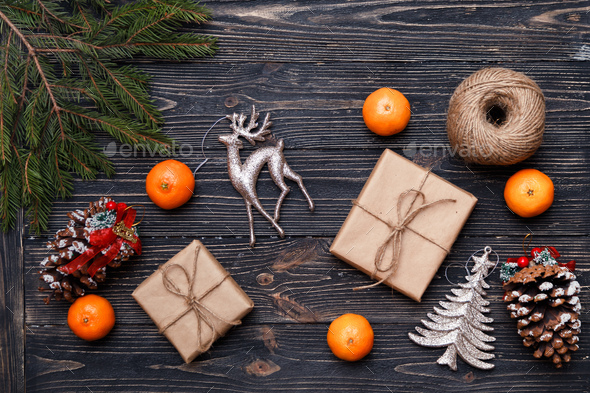 Christmas gifts packed in kraft paper on wooden background. - Stock Photo - Images