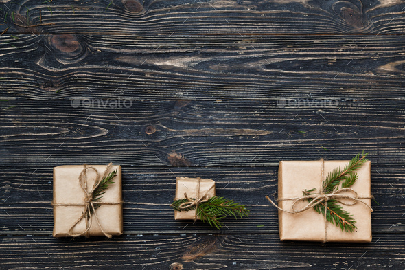 Three Vintage gift boxes with spruce branches on wooden background with copy space - Stock Photo - Images