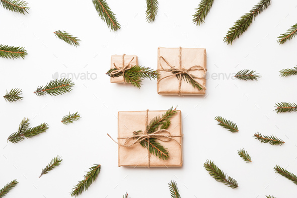 Christmas composition. Christmas gift, word winter made of fir branches. Flat lay, top view - Stock Photo - Images