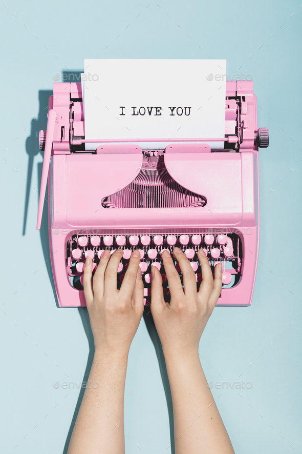 "Woman's hands writing ""I love you"" on a typewriter. - Stock Photo - Images"