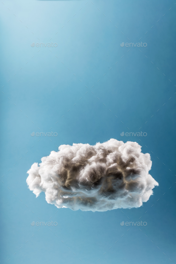 Single cloud on a light blue background. - Stock Photo - Images