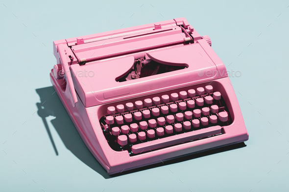 Pink typewriter on a blue pastel background. - Stock Photo - Images