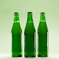Three green bottles on a light green background. - PhotoDune Item for Sale