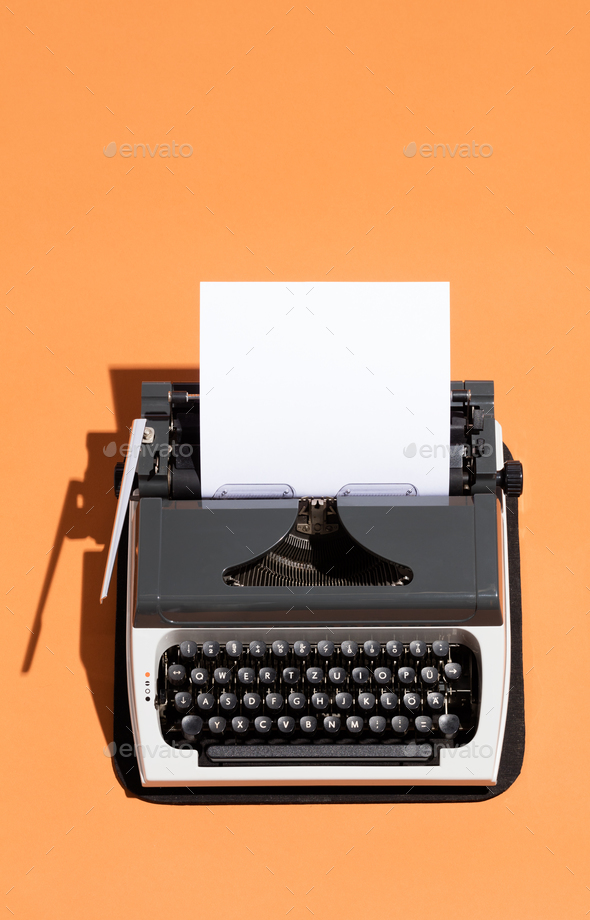 Vintage typewriter with a white blank page - Stock Photo - Images
