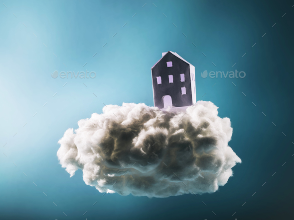 Paper house standing on the cotton cloud - Stock Photo - Images