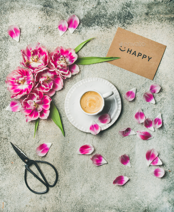 Cup of coffee surrounded with pink tulip flowers - Stock Photo - Images