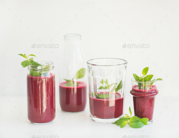 Fresh morning beetroot smoothie or juice in glasses with mint - Stock Photo - Images