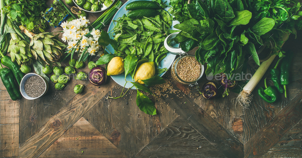 Spring healthy vegan food cooking ingredients, wooden background, wide composition - Stock Photo - Images