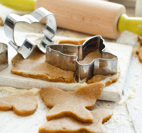 Cooking cookies with  cookie cutters - Stock Photo - Images