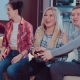 Group of Laughing Male and Female Friends Playing Video Games with Wireless Controllers - VideoHive Item for Sale