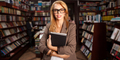 cool geeky girl in bookshop - PhotoDune Item for Sale