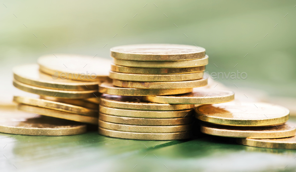 Save money - gold coins - Stock Photo - Images