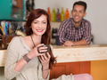 red haired girl smiling in a cafe - PhotoDune Item for Sale