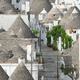 Street along trulli houses in Alberobello - PhotoDune Item for Sale