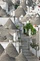 Street along trulli houses in Alberobello - PhotoDune Item for Sale