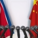 Flags of North Korea and China at International Press Conference - VideoHive Item for Sale