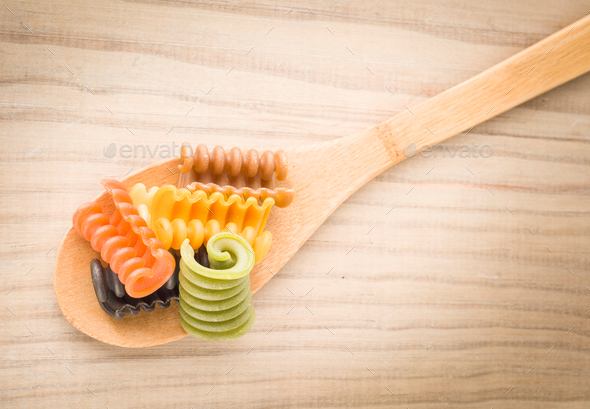 Italian pasta seven flavors on wooden base - Stock Photo - Images