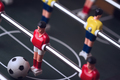 closeup of football figurine on foosball table soccer game - PhotoDune Item for Sale