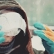 Worker in Overalls Wears a Protective Mask on His Face - VideoHive Item for Sale