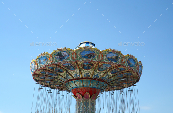 Swing ride at the boardwalk - Stock Photo - Images