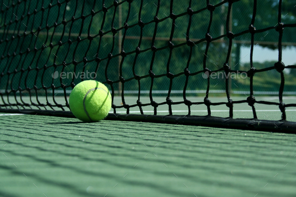 Tennis ball near net - Stock Photo - Images