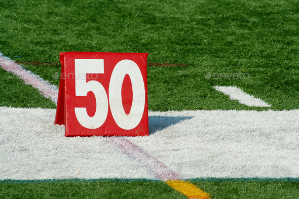 Football fifty yard marker - Stock Photo - Images