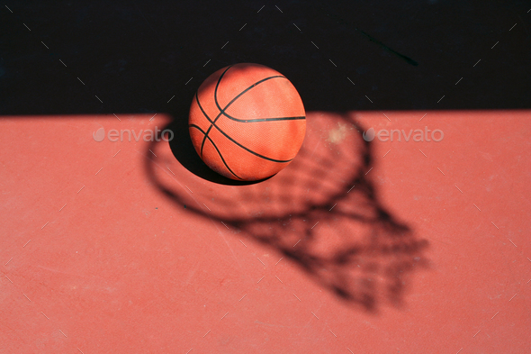 Basketball and net shadow - Stock Photo - Images
