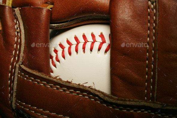 Baseball in a glove - Stock Photo - Images